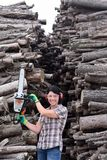 Portrait of a woman with a chainsaw. A portrait of a woman with a chainsaw stock image