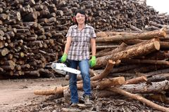 Portrait of a woman with a chainsaw. A portrait of a woman with a chainsaw royalty free stock image