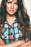 Portrait of woman in check shirt. In studio Royalty Free Stock Images