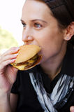 Portrait of woman with cheeseburger royalty free stock photo