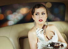 Portrait of a woman with chocolate in a car Stock Photos