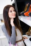 Portrait of woman choosing a pair of footwear Royalty Free Stock Photography