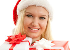Portrait of woman with christmas hat and presents Royalty Free Stock Photography
