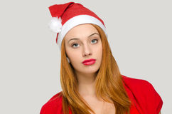 Portrait of a woman with Christmas Santa hat. Royalty Free Stock Image