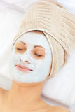 Portrait of a woman with clay mask on her face Royalty Free Stock Photos