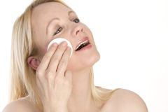 Portrait of a woman cleaning her face. Stock Photography