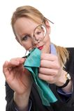 Portrait of a woman cleaning her glasses Stock Photography