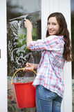 Portrait Of Woman Cleaning House Windows Stock Photo