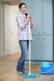Portrait Of Woman Cleaning Kitchen Floor With Mop royalty free stock images