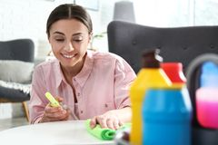 Portrait of woman cleaning table with rag royalty free stock photo