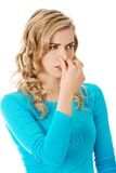 Portrait of a woman clogging nose Stock Photos