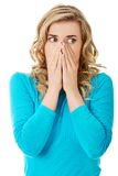 Portrait of a woman clogging nose.  Royalty Free Stock Images