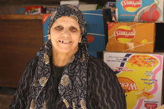 Portrait of an Egyptian Shopkeeper. Portrait of a smiling woman shopkeeper in front of the counter of a bakers ( bread) shop in Giza, Egypt Royalty Free Stock Photos