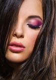 Portrait of woman with closed eyes and brilliant makeup Stock Photo