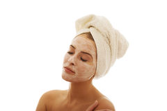 Portrait of woman with closed eyes and face cream Stock Photo