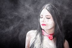 Portrait of a woman in a cloud of white powder Royalty Free Stock Photo