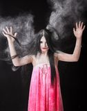 Portrait of a woman in a cloud of white powder Stock Photos