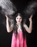 Portrait of a woman in a cloud of white powder Royalty Free Stock Image