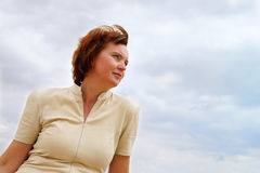 Portrait of a woman in the clouds Royalty Free Stock Photo