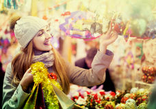 Portrait of  woman in coat posing at Xmas fair in evening Stock Photos