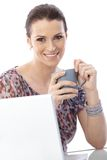 Portrait of woman with coffee and computer Stock Images