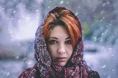 Portrait of a woman in a cold winter. royalty free stock photography