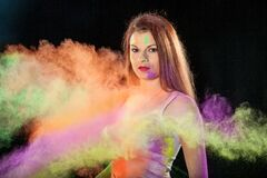 Portrait of woman in colorful smoke Stock Image
