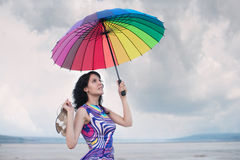 Portrait of a woman with colorful umbrella Stock Image