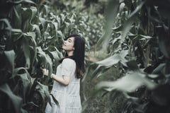 Portrait of woman in corn field