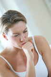 Portrait of a woman coughing Stock Image