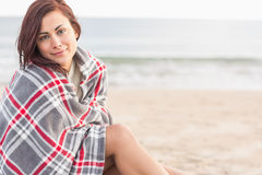 Portrait of a woman covered with blanket at beach Stock Photos