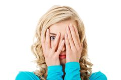 Portrait of a woman covering eyes Royalty Free Stock Photography