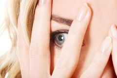 Portrait of a woman covering eyes Stock Photo