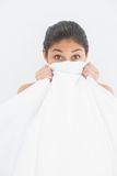 Portrait of a woman covering face with bedsheet Royalty Free Stock Photography