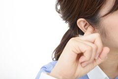 Woman closing ears. Portrait of a woman covering her ears royalty free stock image