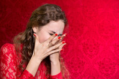 Portrait of a woman covers her face with her hands Stock Photos