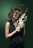 Portrait of a woman with cow's skull in her hands Royalty Free Stock Photos