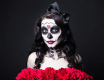Portrait of woman with creative Halloween skull make up and red Royalty Free Stock Photography