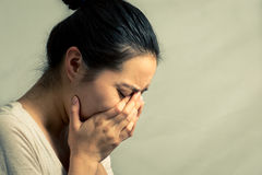 Portrait of woman crying. Portrait of young woman crying desperately, with fashion tone and background Royalty Free Stock Image