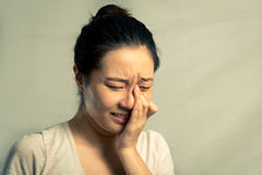 Portrait of woman crying. Portrait of young woman crying desperately, with fashion tone and background Stock Photo