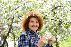 Portrait of  woman with curly hair in  cherry garden in spring Stock Photography