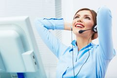 Portrait of woman customer service worker, call center smiling. Operator with phone headset. Young female business model Stock Photo