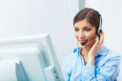 Portrait of woman customer service worker, call center smiling. Operator with phone headset. Young female business model Stock Image