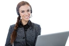 Portrait of a woman customer service worker working at her lapto. Portrait of a beautiful service customer worker holding a laptop. White background. Friendly Royalty Free Stock Images
