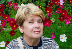 Portrait of a Woman with  dahlias Royalty Free Stock Photography