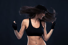 Portrait of a woman dancing with hair in motion. Over black background Stock Photography