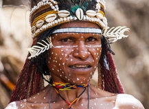 Portrait of Woman Dani tribe in ritual coloring on the body and face. Royalty Free Stock Photography