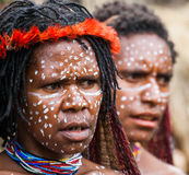 Portrait of Woman Dani tribe in ritual coloring on the body and face. Royalty Free Stock Photo