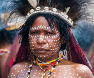 Portrait of Woman Dani tribe in ritual coloring on the body and face. Royalty Free Stock Images