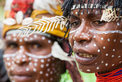 Portrait of Woman Dani tribe in ritual coloring on the body and face. Stock Image